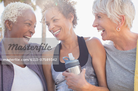 Senior women laughing in sportswear Stock Photo - Premium Royalty-Free, Image code: 6113-07589342