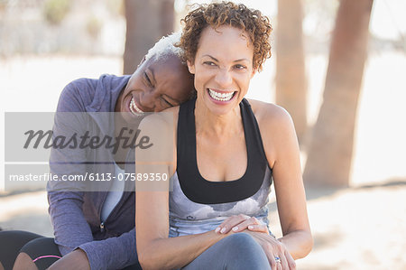 Women laughing outdoors Stock Photo - Premium Royalty-Free, Image code: 6113-07589350