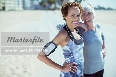 Portrait of smiling women in sportswear outdoors Stock Photo - Premium Royalty-Free, Image code: 6113-07589389