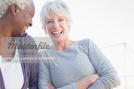 Senior women laughing outdoors Stock Photo - Premium Royalty-Free, Image code: 6113-07589437
