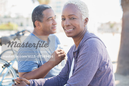 Portrait of smiling couple outdoors Stock Photo - Premium Royalty-Free, Image code: 6113-07589456