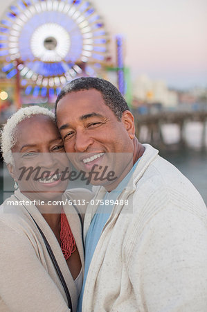 Portrait of happy senior couple at amusement park Stock Photo - Premium Royalty-Free, Image code: 6113-07589488