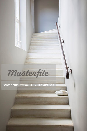 Slippers on whitewashed staircase Stock Photo - Premium Royalty-Free, Image code: 6113-07589729