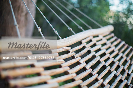 Wooden hammock Stock Photo - Premium Royalty-Free, Image code: 6113-07589738