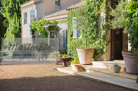 Sunny luxury villa Stock Photo - Premium Royalty-Free, Image code: 6113-07589743