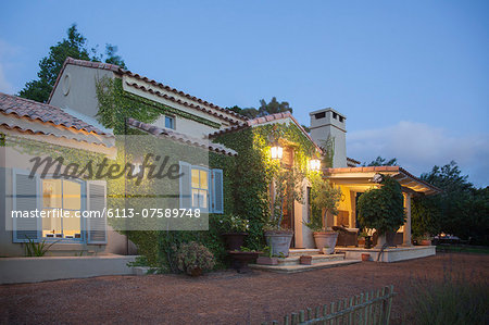 Luxury villa illuminated at night Stock Photo - Premium Royalty-Free, Image code: 6113-07589748