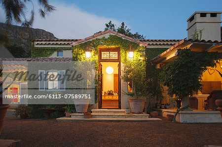 Luxury villa illuminated at night Stock Photo - Premium Royalty-Free, Image code: 6113-07589751