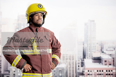 Portrait of confident fireman in urban window Stock Photo - Premium Royalty-Free, Image code: 6113-07648744