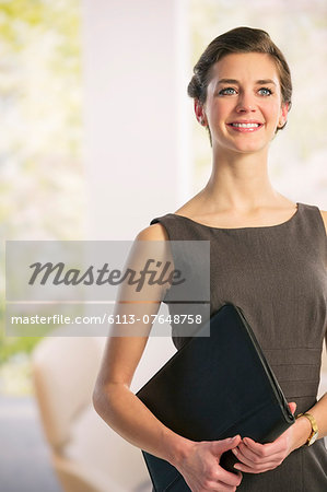 Portrait of confident businesswoman Stock Photo - Premium Royalty-Free, Image code: 6113-07648758