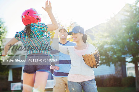 Family playing baseball Stock Photo - Premium Royalty-Free, Image code: 6113-07648763