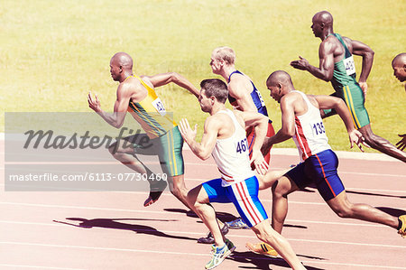 Sprinters racing on track Stock Photo - Premium Royalty-Free, Image code: 6113-07730460