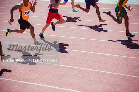 Runners racing on track Stock Photo - Premium Royalty-Free, Image code: 6113-07730466