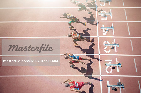 Runners taking off from starting blocks on track Stock Photo - Premium Royalty-Free, Image code: 6113-07730484