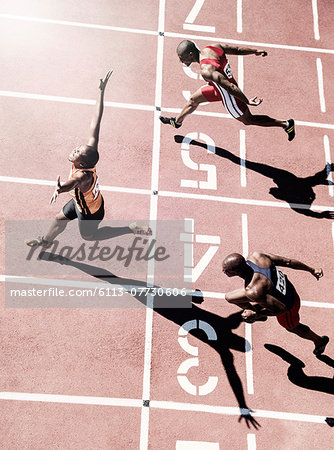 Runners crossing finish line Stock Photo - Premium Royalty-Free, Image code: 6113-07730606