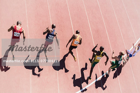 Runners racing on track Stock Photo - Premium Royalty-Free, Image code: 6113-07730611