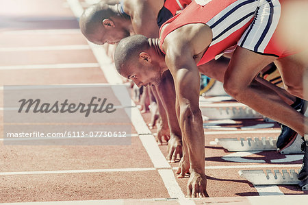 Runners ready at starting block Stock Photo - Premium Royalty-Free, Image code: 6113-07730612