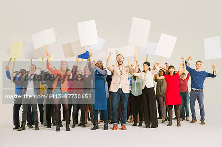 Diverse crowd with picket signs Stock Photo - Premium Royalty-Free, Image code: 6113-07730652