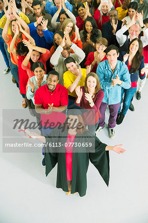 Clapping crowd behind graduate Stock Photo - Premium Royalty-Free, Image code: 6113-07730659