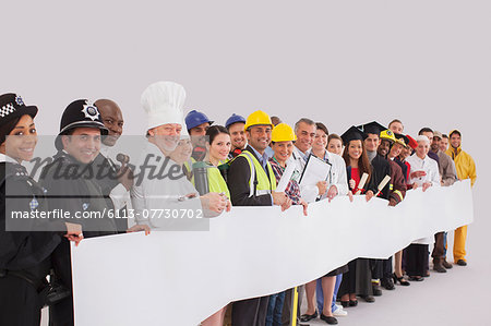 Portrait of diverse workforce with blank signs Stock Photo - Premium Royalty-Free, Image code: 6113-07730702