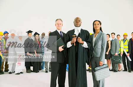 Workforce behind confident lawyers and judge Stock Photo - Premium Royalty-Free, Image code: 6113-07730724