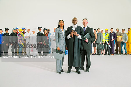 Workforce behind confident judge and lawyers Stock Photo - Premium Royalty-Free, Image code: 6113-07730738