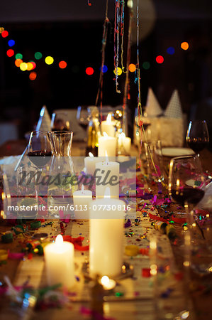 Lit candles on table at party Stock Photo - Premium Royalty-Free, Image code: 6113-07730816