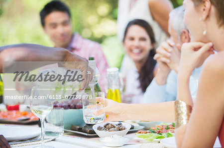 Friends eating together outdoors Stock Photo - Premium Royalty-Free, Image code: 6113-07730878