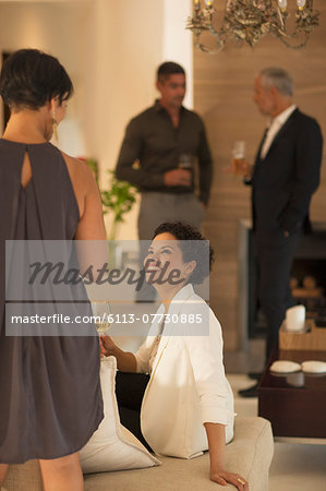 Women talking at party Stock Photo - Premium Royalty-Free, Image code: 6113-07730885