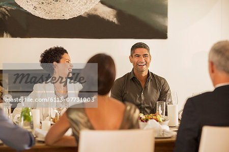 Friends laughing at dinner party Stock Photo - Premium Royalty-Free, Image code: 6113-07731003