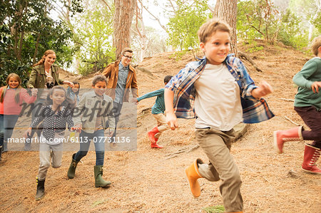 Children running in forest Stock Photo - Premium Royalty-Free, Image code: 6113-07731136