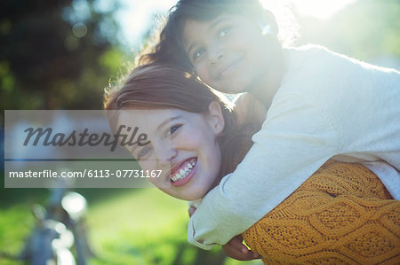 Mother carrying daughter on shoulders Stock Photo - Premium Royalty-Free, Image code: 6113-07731167