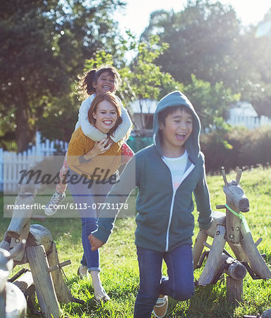 Students and teacher walking outdoors Stock Photo - Premium Royalty-Free, Image code: 6113-07731178