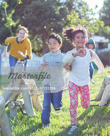 Children running on playground Stock Photo - Premium Royalty-Free, Image code: 6113-07731196