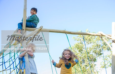 Children playing on play structure Stock Photo - Premium Royalty-Free, Image code: 6113-07731259