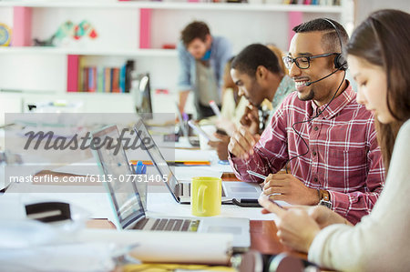 People working at conference table in office Stock Photo - Premium Royalty-Free, Image code: 6113-07731405