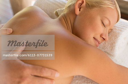 Woman having massage in spa Stock Photo - Premium Royalty-Free, Image code: 6113-07731539