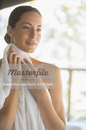 Woman toweling herself off Stock Photo - Premium Royalty-Free, Image code: 6113-07731545