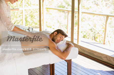 Man having massage in spa Stock Photo - Premium Royalty-Free, Image code: 6113-07731570