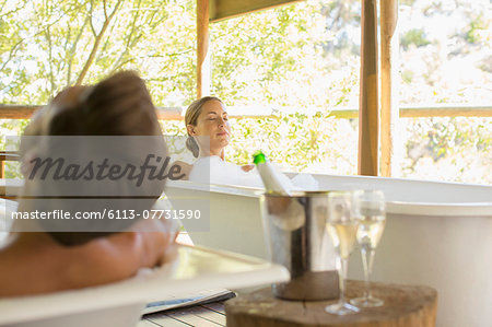 Couple relaxing together in spas Stock Photo - Premium Royalty-Free, Image code: 6113-07731590