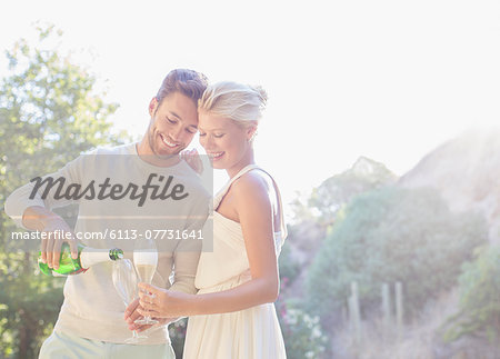 Couple drinking champagne outdoors