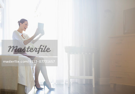 Businesswoman using digital tablet in hotel room Stock Photo - Premium Royalty-Free, Image code: 6113-07731657
