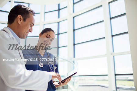 Doctor and nurse reading medical chart in hospital