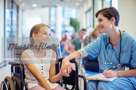Nurse holding patient's hands in hospital Stock Photo - Premium Royalty-Free, Image code: 6113-07762048