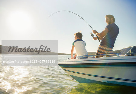Father and son fishing on boat Stock Photo - Premium Royalty-Free, Image code: 6113-07762119