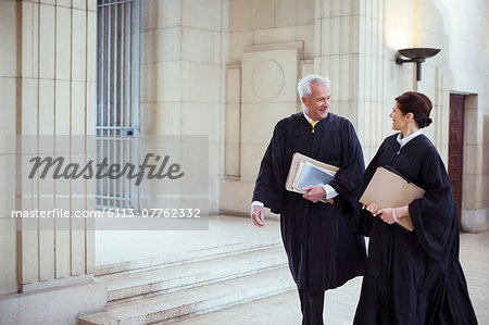 Judges walking through courthouse together Stock Photo - Premium Royalty-Free, Image code: 6113-07762332
