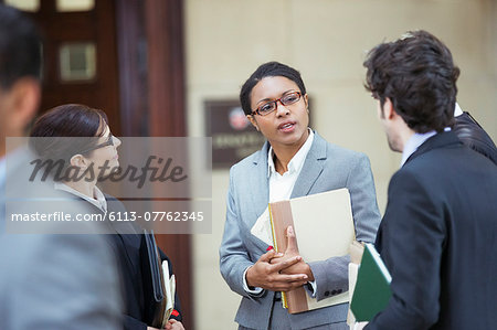 Lawyers talking outside courtroom Stock Photo - Premium Royalty-Free, Image code: 6113-07762345