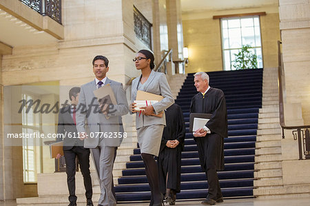 Judges and lawyer walking through courthouse Stock Photo - Premium Royalty-Free, Image code: 6113-07762358