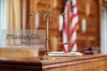 Scales of justice on the judge's bench Stock Photo - Premium Royalty-Free, Image code: 6113-07762359