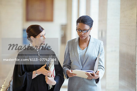Judge and lawyer talking in courthouse Stock Photo - Premium Royalty-Free, Image code: 6113-07762384