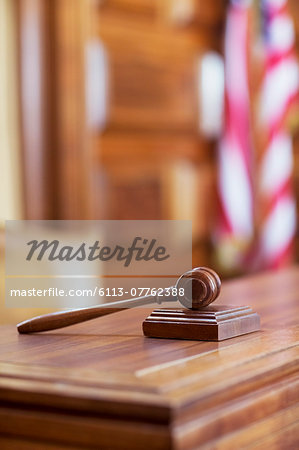 Gavel laying on judge's bench in court Stock Photo - Premium Royalty-Free, Image code: 6113-07762388